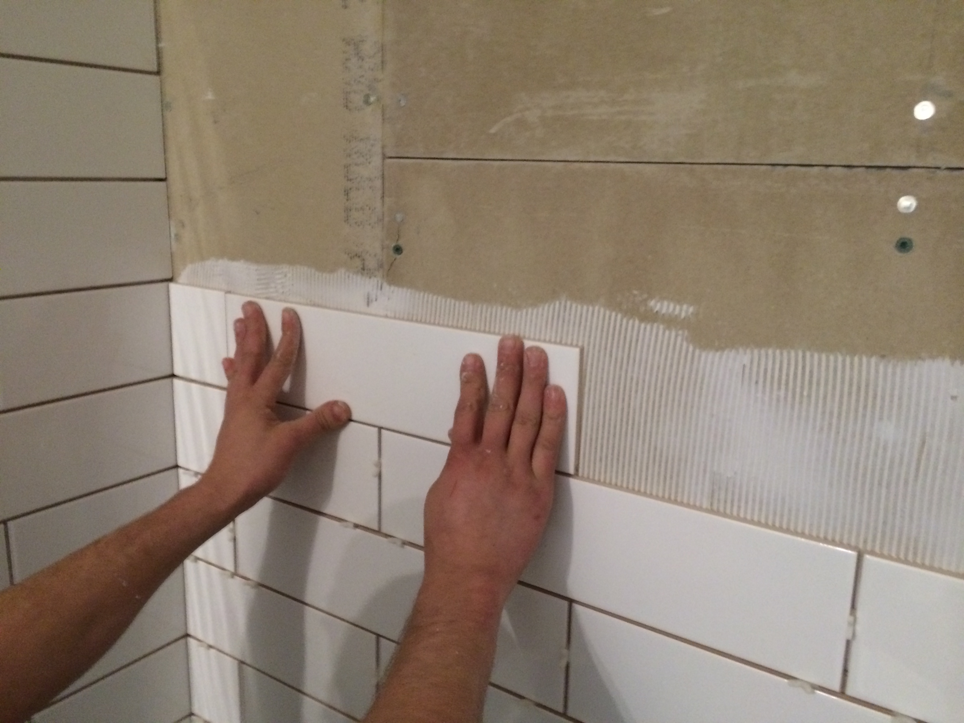 Setting bathroom tiles